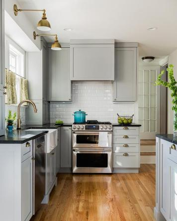 grey-shaker-kitchen-cabinets-brass-cup-pulls-soapstone-countertops